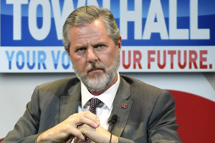Photo appears to show Jerry Falwell Jr. with zipper down and arm around a woman