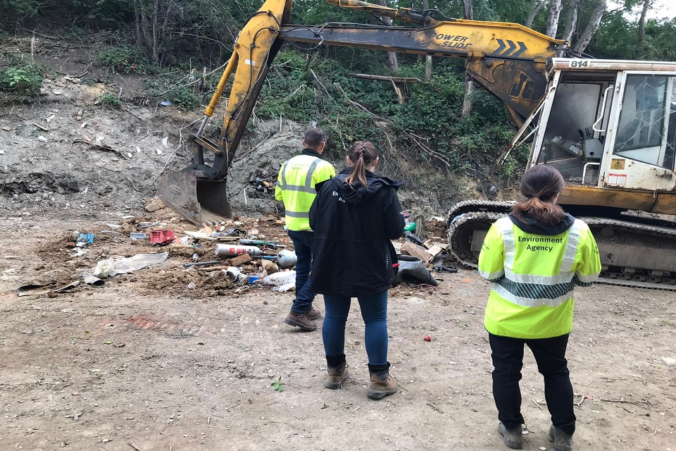 Officers inspecting the Abbey Skips site.