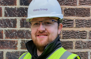 David Duncan in a white hard hat smiling straight at the camera.