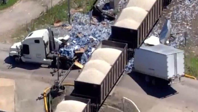 Semi carrying water bottles split in half by train (Video)