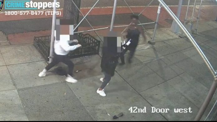 Video shows stranger attacking Asian woman with hammer in NYC (Watch)