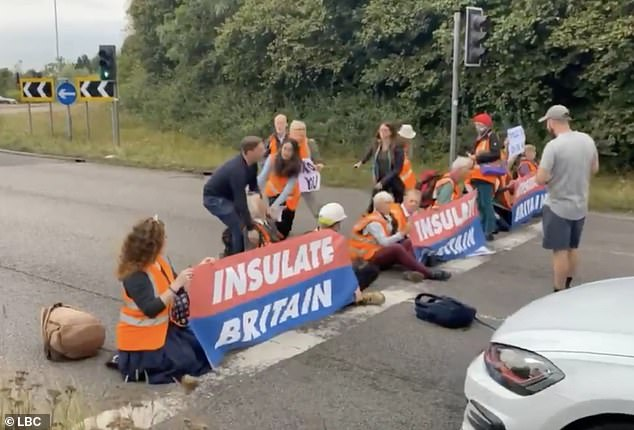 Four cars collide as climate protesters block part of M25